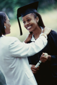Female graduate standing with her mother